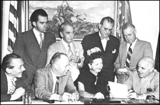 Elizabeth Bentley with members of the HUAC: JohnMcDowell, Richard Nixon, Karl Mundt, John Rankin,F. E. Hebert, J. H. Peterson and J. Parnell Thomas.