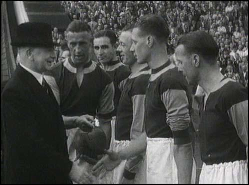 Charlie Bicknell introduces the West Ham players before the game.