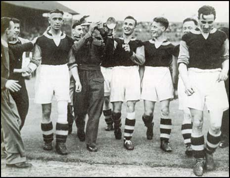 The West Ham team celebrate victory in the 1940 War Cup Final. Left to right, CharlieBicknell, Norman Corbett (in uniform), Ted Fenton, Norman Corbett and Len Goulden.