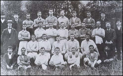 West Ham in 1899. Back (left to right): C. Barker, A. Woodcock, Charles Craig,H. Sunderland, Henry Gilmore, F. Adams. Second row: Fred Corbett, Charlie Dove,Tommy Dunn, Syd King, James Bigden, L. Foss, M. Higham, Sam Wright (trainer).Seated; W. James, Ken McKay, Tommy Moore, Albert Carnelly, Tom Bradshaw.Front; J. Walker, Peter McManus, Bill Joyce, Roderick McEachrane, Simon Chisholm.