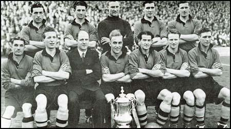 The Wolves team that won the FA Cup victory in 1949 against Leicester City.Back row (left to right): Billy Crook, Roy Pritchard, Bert Williams, Bill Shorthouse,Terry Springthorpe. Front row: Johnny Hancocks, Sammy Smythe, Stan Cullis,Jesse Pye, Jimmy Dunn and Jimmy Mullen.
