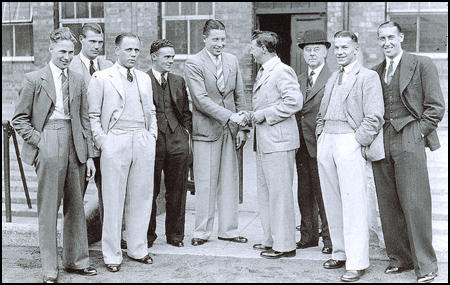 Alex Scott, centre, meets the rest of the team after his transfer in 1935.