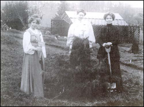 Annie Kenney, Mary Blathwayt and Emmeline Pankhurst planting trees at Eagle House.