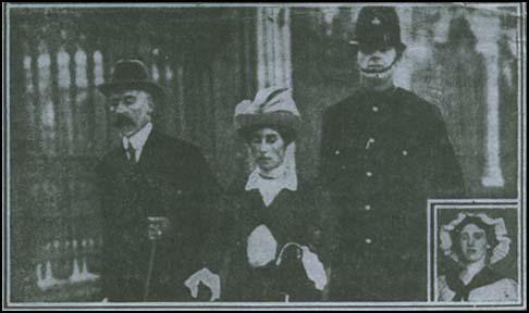 Newspaper photograph of Evelyn Sharp being arrestedon 24th August, 1913. Inset is Sybil Smith.