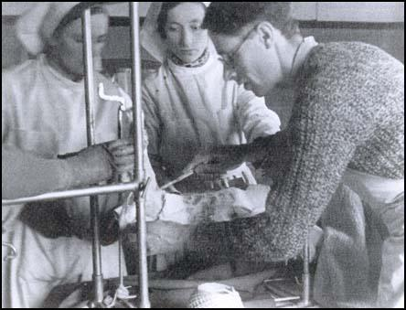 Thora Silverthorne with Dr Alex Tudor-Hart in a field operating theatre.